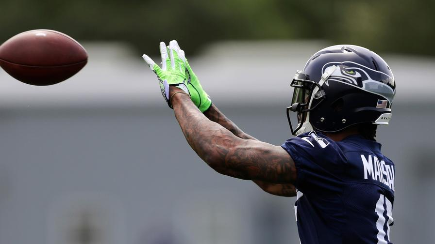 b8c13d003 Brandon Marshall s going to the Seattle Seahawks on a one-year deal. What  does this do to the fantasy football outlooks of Russell Wilson